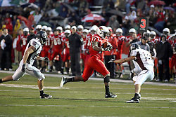 25 September 2010:  Brandon Venson is pursued by Skylar Smith and block by Derek Miller as he works his way around the left side. The Missouri State Bears lost to the Illinois State Redbirds 44-41 in double overtime, meeting at Hancock Stadium on the campus of Illinois State University in Normal Illinois.