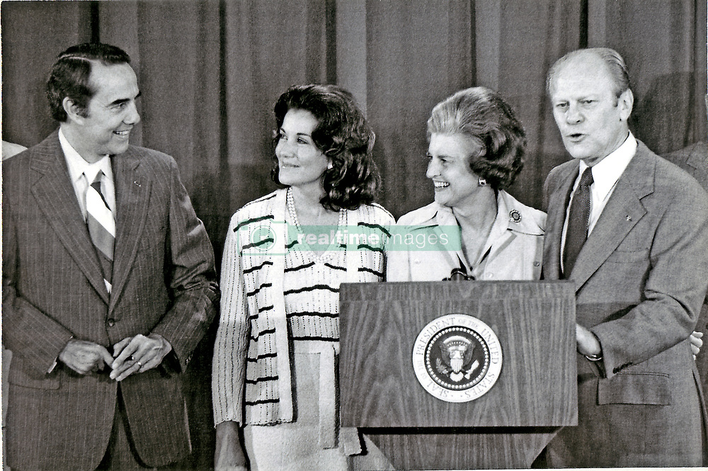 United States President Gerald R. Ford, right, announces US Senator Bob Dole (Republican of Kansas), left, as his running mate, during a press conference at the Crown Center Hotel during the 1976 Republican National Convention in Kansas City, Missouri on August 19, 1976.  From left to right: Senator Bob Dole; his wife, Commissioner of the Federal Trade Commission, Elizabeth Hanford Dole; first lady Betty Ford; President Ford.<br /> Credit: Arnie Sachs / CNP