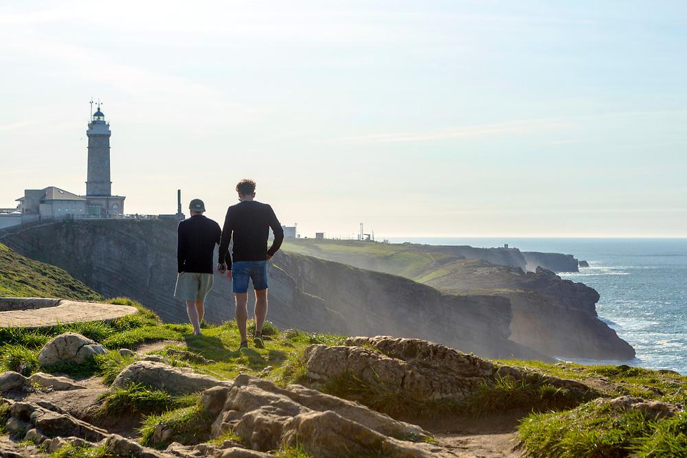 SANTANDER, SPAIN - April 17 2018, Tourists stroll along the coastline surrounding Cabo Mayor Lighthouse, Santander, Spain, Europe.