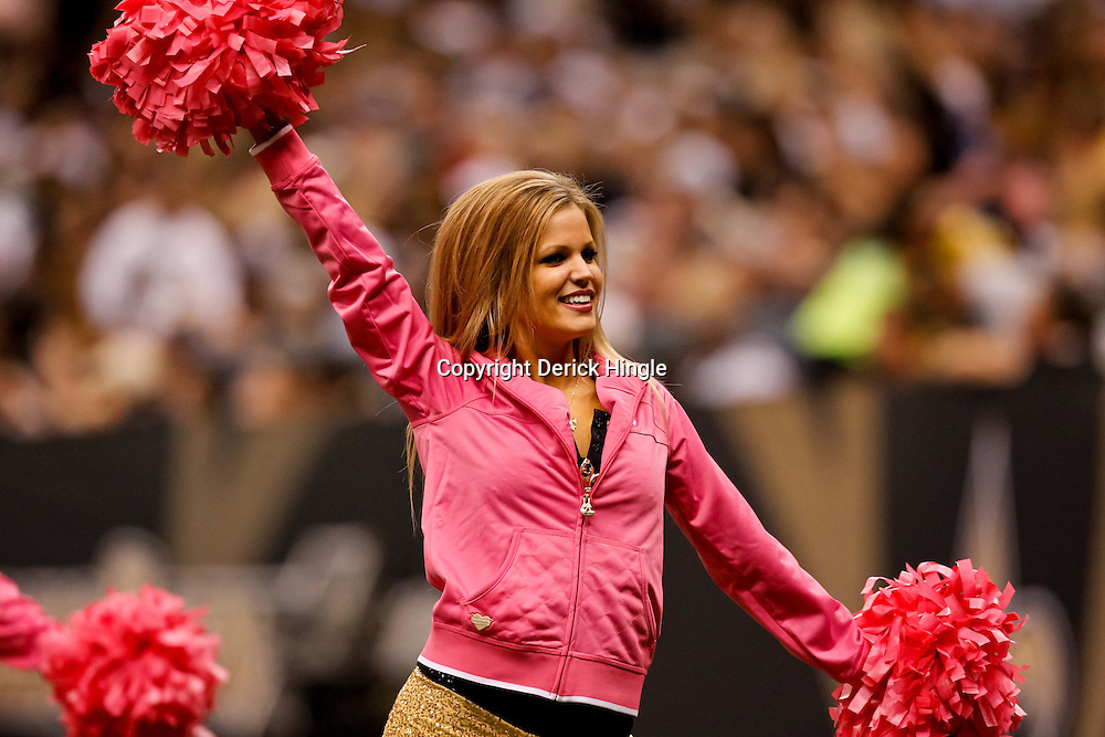 October 3, 2010; New Orleans, LA, USA; A New Orleans Saints Saintsations cheerleader performs during a game between the New Orleans Saints and the Carolina Panthers at the Louisiana Superdome. The Saints defeated the Panthers 16-14. Mandatory Credit: Derick E. Hingle