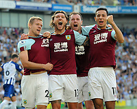 Football - 2019 / 2020 Premier League - Brighton & Hove Athletic vs. Burnley<br /> <br /> Jeff Kendrick of Burnley celebrates scoring their late equaliser with Matej Vydra (left) and Ashley Barnes and Dwight McNeil (right), at The Amex.<br /> <br /> COLORSPORT/ANDREW COWIE