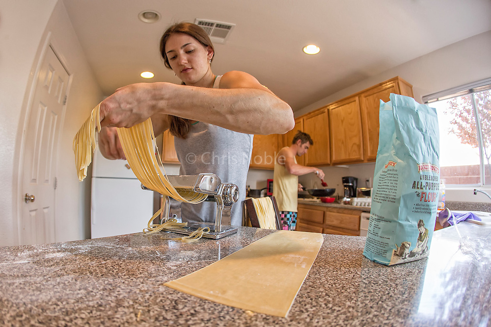 Pro climbers Paige Claassen and Arjan De Kock make home made pasta for lunch at their rented condo in Las Vegas