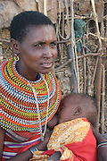 Africa, Tanzania, Samburu Maasai woman and baby an ethnic group of semi-nomadic people February 2006