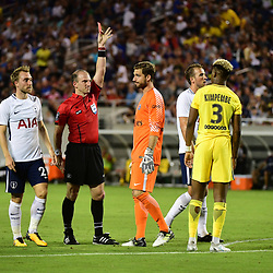 (L-R) Kevin Trapp of PSG receives a red card from referee Ted Unkel for denying Harry Kane of Spurs a clear goal scoring opportunity during the International Champions Cup match between Paris Saint Germain and Tottenham Hotspur on July 22, 2017 in Orlando, United States. (Photo by Dave Winter/Icon Sport)