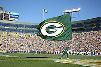 GREEN BAY, WI - OCTOBER 17: Cheearleader of the Green Bay Packers waves a flag after a touchdown against the Miami Dolphins at Lambeau Field on October 17, 2010 in Green Bay, Wisconsin. The Dolphins defeated the Packers 23-20 in overtime. (Photo by Tom Hauck/Getty Images) *** Local Caption ***