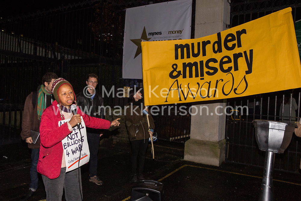 London, UK. 26 November, 2019. Sara Callaway addresses activists from Global Justice Rebellion and London Mining Network holding a 'Murder & Misery Awards' protest outside the Mines and Money awards ceremony at the Honorary Artillery Company which is attended by mining company delegates, investors and government representatives. The activists were protesting to highlight the environmental impact of mining and the manner in which mining companies are increasingly attempting to 'greenwash' their activities by claiming that they are indispensable in a transition to sustainables.