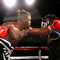 Joseph White throws a left hand to the head of Jordan Sanders during a Fire Fist Boxing Promotions boxing match at the A La Carte Pavilion on Saturday, August 12 , 2017 in Tampa, Florida.  (Alex Menendez via AP)