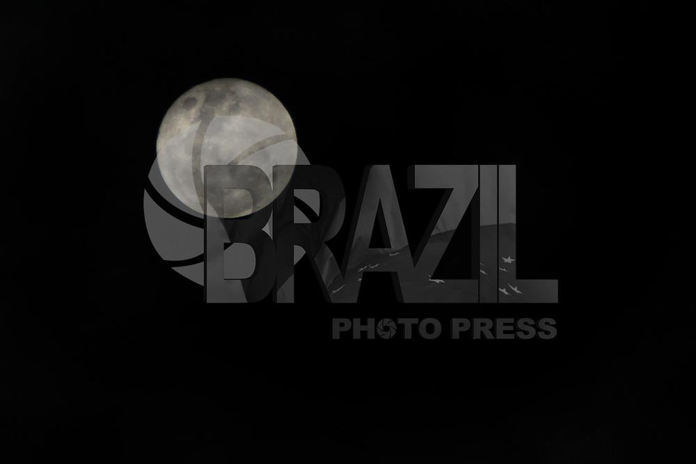 CURITIBA, PR, 17 DE MAIO 2011 – LUA CHEIA – Mesmo com uma noite fria, e algumas nuvens, foi possível visualizar bem a lua cheia que começou nesta terça-feira (17) e permanece até a próxima segunda-feira (23). (FOTO: ROBERTO DZIURA JR./ NEWS FREE)