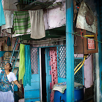 Though the residents of Yashwant Nagar in the Bandra suburb of Mumbai live in a congested neighborhood, they enjoy security of tenure and benefit from a strong civic sense - the result of a long-established community living in the area. Yashwant Nagar is about to be demolished to make way for a new housing development that will accomodate exisitng residents. ..The BMC (Brihanmumbai Municipal Corporation) uses the UNDP-devised Human Development Index (HDI) as a measure by which to allocate resources. ..Using parameters like population, literacy rate and infant mortality, and ranking wards in the order of performance, the BMC apportions funds to areas with lower education and higher mortality rates. The BMC also encourages the participation of Mumbai's citizens in the monitoring of education and health projects...Photo: Tom Pietrasik.Mumbai, India.September 8th 2010