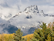 Clouds dance over the peaks of Grand Teton National Park, Wyoming, USA. The 40 mile (64 km) long Teton Range is the youngest mountain chain in the Rocky Mountains, and began their uplift 9 million years ago, during the Miocene Epoch. A parkway connects from Grand Teton National Park 10 miles north to Yellowstone National Park. Surrounding parkland and National Forest constitute the Greater Yellowstone Ecosystem, one of the largest intact mid-latitude temperate ecosystems in the world.