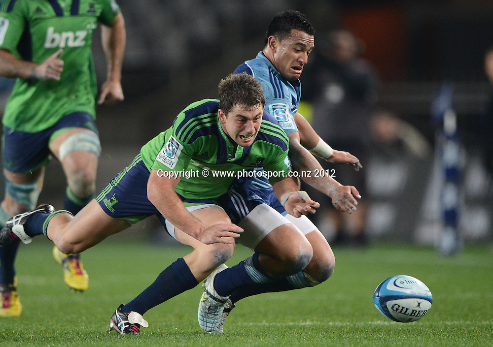 Kurt Baker and Sherwin Stowers go for the ball during the Blues and Highlanders at Eden Park, Auckland, New Zealand on Saturday 26 May 2012. Photo: Andrew Cornaga/Photosport.co.nz