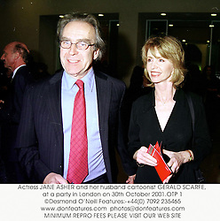 Actress JANE ASHER and her husband cartoonist GERALD SCARFE, at a party in London on 30th October 2001.OTP 1