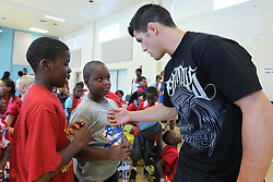 August 4, 2011; Philadelphia, PA; USA; Dominick Cruz speaks to children at the Boys & Girls Club in Philadelphia.