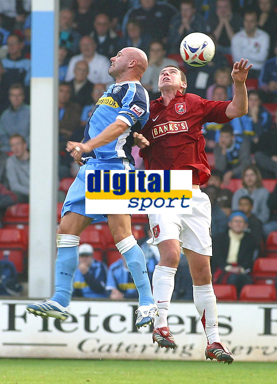 Photo: Dave Linney.<br />Walsall v Wycombe Wanderers. Coca Cola League 2. 14/10/2006.Walsall's Anthony Gerrard(r) heads clear as Tommy Mooney  closes in .