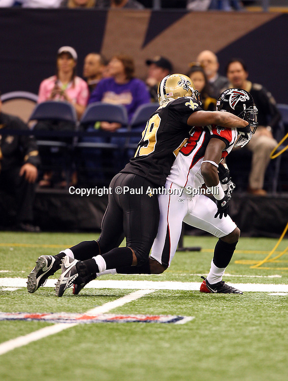 NEW ORLEANS - DECEMBER 07: Safety Josh Bullocks #29 of the New Orleans Saints tackles wide receiver Harry Douglas #83 of the Atlanta Falcons at the Louisiana Superdome on December 7, 2008 in New Orleans, Louisiana. The Saints defeated the Falcons 29-25. ©Paul Anthony Spinelli *** Local Caption *** Josh Bullocks;Harry Douglas