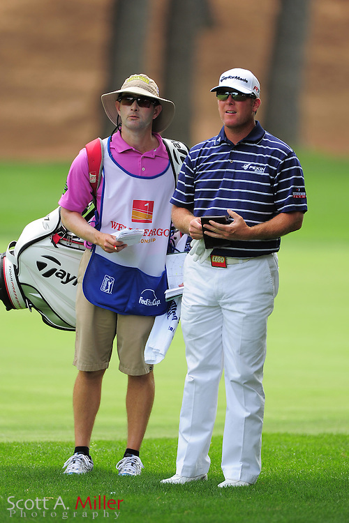 D.A. Points and his caddie during the third round of the Wells Fargo Championship at the Quail Hollow Club on May 5, 2012 in Charlotte, N.C. ..©2012 Scott A. Miller.