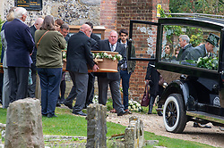 © Licensed to London News Pictures. 03/10/2019. High Wycombe, UK. A coffin is carried to a waiting hearse as family and friends depart St Lawrence's Church in High Wycombe after the funeral of Libby Squire. Libby Squire was a 21-year-old Hull University student and originally from High Wycombe she disappeared after a night out in Hull on February 1st, 2019. After extensive searches her body was found close to Spurn Point on March 20th, 2019. Photo credit: Peter Manning/LNP