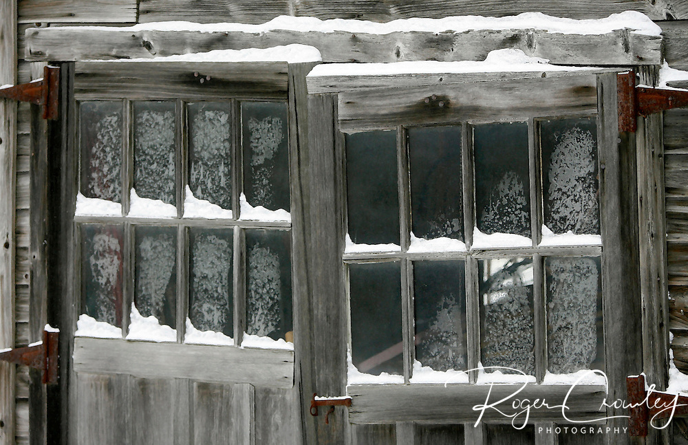 Roger Crowley / CrowleyPhotos.com   ..Frost cover windows on old barn doors in East Montpelier Vermont..