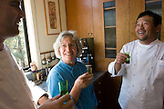 Sean Knight, Cindy Pawlcyn and Ken Tominaga drink saki in Cindy's St. Helena kitchen in the Napa Valley. Shot in Cindy's home kitchen in St. Helena, CA.