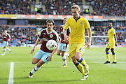 Burnley midfielder Joey Barton (13)  closes down Leeds United defender, Charlie Taylor (21)  during the Sky Bet Championship match between Burnley and Leeds United at Turf Moor, Burnley, England on 9 April 2016. Photo by Simon Davies.
