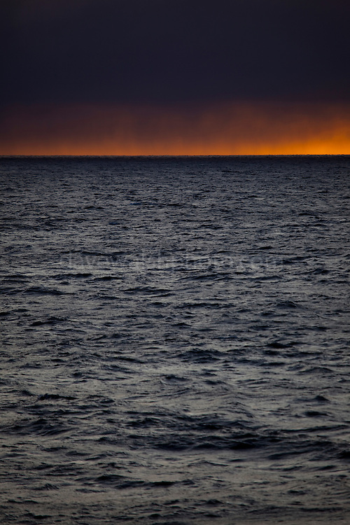 """Snowing on the sunset at the mouth of Isfjord, Svalbard This mage can be licensed via Millennium Images. Contact me for more details, or email mail@milim.com For prints, contact me, or click """"add to cart"""" to some standard print options."""