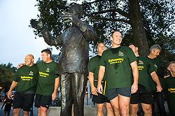 © London News Pictures. 24/10/2015. London, UK. Captain of the 1995 South African Rugby World Cup winning team, FRANCOIS PIENAAR (centre) and other members of the winning team stand next to statue of Nelson Mandela, mid-way through taking part in an early morning, 2 mile run around westminster to mark the anniversary of in the 1995 winning team going for a morning jog. The event takes place on the morning of the Rugby World Cup semi-final between South Africa and New Zealand. Photo credit: Ben Cawthra /LNP