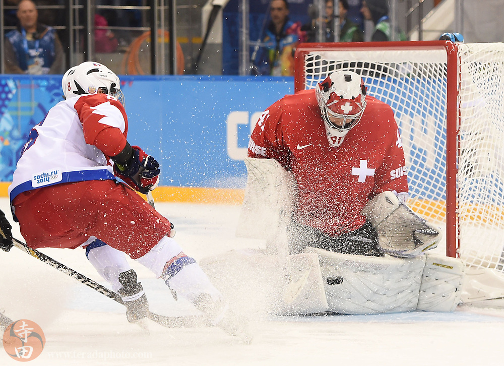 Feb 15, 2014; Sochi, RUSSIA; Switzerland goalkeeper Florence Schelling (41) makes a save on a shot by Russia forward Iya Gavrilova (8) in a women's quarterfinals ice hockey game during the Sochi 2014 Olympic Winter Games at Shayba Arena.