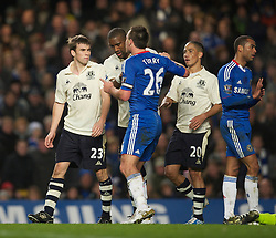 LONDON, ENGLAND - Saturday, December 4, 2010: Everton's youngster Seamus Coleman is accosted by a rabid Chelsea captain John Terry during the Premiership match at Stamford Bridge. (Pic by: David Rawcliffe/Propaganda)