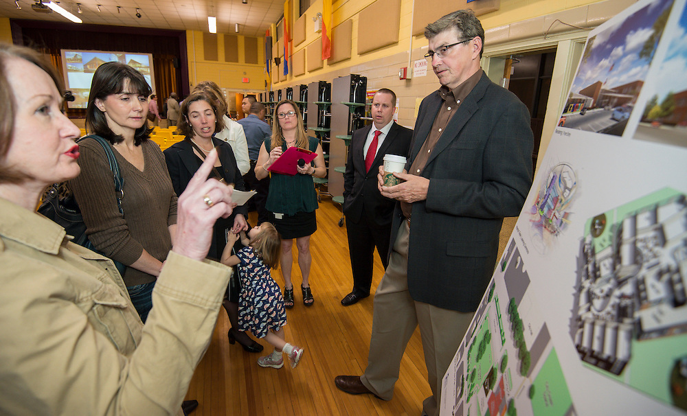 Representatives of VLK Architects meet with parents and staff of Condit Elementary School during a Bond Community Meeting at the school, February 25, 2014.