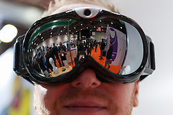© Licensed to London News Pictures. 15/03/2016. London, UK. A man tries on a set of ski goggles that incorporates its own mobile camera technology in the frame.  Technology fans visit the Wearable Technology Show at the Excel Centre.  The largest dedicated event for connected technology, the show features innovative products from start-ups as well as products from major technology companies and includes the latest in virtual reality and augmented reality devices and software. Photo credit : Stephen Chung/LNP