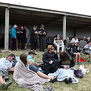 Spectators study form during the Roxburgh Trotting Club Summer Festival Races, Roxburgh, Otago, New Zealand. 5th January 2012