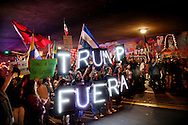 Demonstrators stage a rally against President elect Donald Trump in the Barrio Logan area of in San Diego, California, U.S. November 11, 2016.  REUTERS/Sandy Huffaker