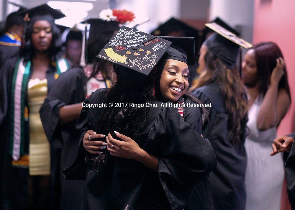 RIVERSIDE, CA - JUNE 11, 2017: Graduates hug each other before the Black Graduation Ceremony at University of California, Riverside, Sunday June 11, 2017. (Photo by Ringo H.W. Chiu / For The Times)(Photo by Ringo Chiu)<br /> <br /> Usage Notes: This content is intended for editorial use only. For other uses, additional clearances may be required.