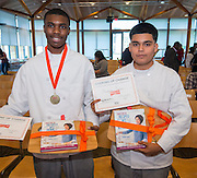 Barbara Jordan High School students Malik Preston, left, and Christopher Zavala, right, pose for a photograph after being named runners-up in the Cooking for Change challenge at Rice University, April 12, 2014.