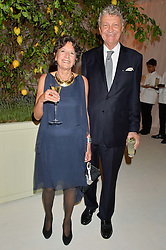 WILLIAM & OLGA SHAWCROSS at a dinner hosted by Cartier in celebration of The Chelsea Flower Show held at The Hurlingham Club, London on 19th May 2014.