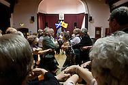 Guests singing Auld Lang Syne at the end of a St. Andrew's dinner dance held by the Sandbach and District Caledonian Society at Sandbach Town Hall, Cheshire, England on St. Andrew's Day. Around 40 people from the Society attended the meal and dance which included a programme of Scottish country dancing. St. Andrew was the patron saint of Scotland and the day was celebrated by Scots worldwide on the 30th November.