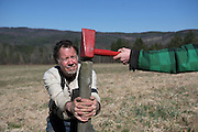 Craig Wortman resets a fence post with help from Luke Dezan, 16, of Randolph, Vt., in a pasture in Bethel, Vt., Saturday, April 22, 2016. The Wortmans have agreements with several local land owners to use their land for grazing in the summer in exchange for the upkeep and improvement of the pasture land. (Valley News - James M. Patterson) Copyright Valley News. May not be reprinted or used online without permission. Send requests to permission@vnews.com.