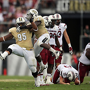 UCF Knights defensive lineman E.J. Dunston (95) celebrates during an NCAA football game between the South Carolina Gamecocks and the Central Florida Knights at Bright House Networks Stadium on Saturday, September 28, 2013 in Orlando, Florida. (AP Photo/Alex Menendez)