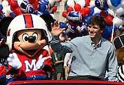 Feb 6, 2012;  Lake Buena Vista, FL, USA; New York Giants quarterback and Super Bowl XLVI most valuable player Eli Manning participates in a ticker-tape parade on Main Street at Walt Disney World's Magic Kingdom.
