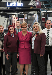 Pictured: The First Minister tours a bus garage and met Lothian Buses driver Charmaine Laurie (right), who famously controlled her bus on ice during the Beast from the East last year, and her daughter trainee driver Jade Laurie (left)<br /> <br /> First Minister Nicola Sturgeon emphasised the need for climate change to be at the heart of the programme for Government, ahead of the announcement, on a visit to Lothian Buses depot in Edinburgh.<br /> <br /> © Dave Johnston / EEm