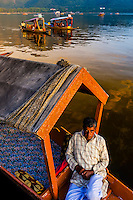 A shikara (boat) on Dal Lake in Srinagar, Kashmir, Jammu and Kashmir State, India.