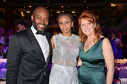 SIR OG & LADY AMAZU and SARAH, DUCHESS OF YORK at The Butterfly Ball in aid of Caudwell Children held at the Grosvenor House, Park Lane, London on 25th June 2015