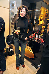 MARIE HELVIN at a Champagne & chocolate party hosted by Roger Vivier at their store in Sloane Street, London on 12th February 2009.  The evening was in aid of The Silver Lining charity.