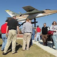 Adam Robison | BUY AT PHOTOS.DJOURNAL.COM<br /> A crowd gathers around the F-105 Thunderchief that was dedicated at the Veterans Day Ceremony Wednesday morning at Veterans Park in Tueplo.