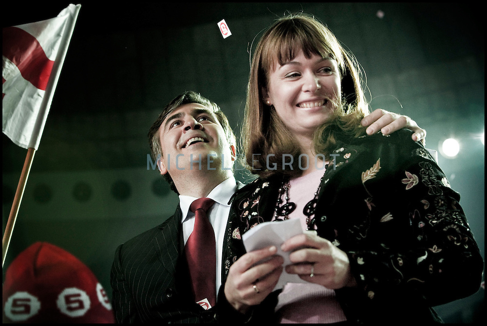 "President Mikhail Saakashvili (his wife Sandra Roelofs on the right) speaking to is supporters in the Sport Palace in Tbilisi, Georgia on 04 January, 2008 on the day before the Presidential Elections. Saakashvili was elected president in January 2004. OSCE observers described the vote as a ""welcome contrast"" to a rigged parliamentary poll the previous November. Mr Saakashvili had led the ''Rose Revolution'' protests which followed that election, forcing his predecessor as president, Eduard Shevardnadze, to resign. Soon after that, Mr Saakashvili consolidated his position when his National Movement-Democratic Front won parliamentary elections. It holds the majority of seats and opposition representation is extremely weak. However, after last months protests of the opposition, that were violently stopped by the police, several parties expect that there will be again demonstrations organized by the (pro Russian) opposition if Saakashvili will win the elections held on January 5. **FRANCE NEWSPAPERS OUT UNTIL JANUARY 6, 2008**"