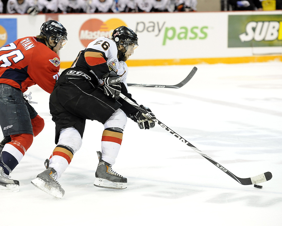 Joel Broda of the Calgary Hitmen holds off Kenny Ryan of the Windsor Spitfires in Game 4 of the 2010 MasterCard Memorial Cup in Brandon, MB on Monday May 17. Photo by Aaron Bell/CHL Images