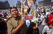 "jku032303056 - 31 JULY 2002 - MEXICO CITY, DF, MEXICO: People pray on the Zocalo in the historic center of Mexico City during a Papal mass televised to the Zocalo on large screen ""jumbotron"" televisions. The mass, led by Pope John Paul II, was at the Basilica of Guadalupe in Mexico City, July 31, 2002. The Pontiff, making his fifth trip to Mexico, canonized Juan Diego, the Mexican Indian who first saw the image of the Virgin of Guadalupe in 1531. Juan Diego is now known at Saint Juan Diego. PHOTO © JACK KURTZ  RELIGION  INDIGENOUS  CULTURE  PATRIOTISM"