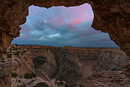 I've seen pictures of this arch at Bighorn Canyon before, and haven't been able to locate it. But after visiting a 3rd time, I finally found it. The arch frames an incredible view of what is sometimes called Montana's Grand Canyon. After waiting here until 9PM, I gave up on seeing any color in the sky. But before I could make it back to my car, an orange glow emerged in the west and pink clouds briefly overtook the sky. I hurried back to the arch to take this final picture. It always amazes me just how empty this place is. It's not unusual to see more wild horses than people. I had to drive very carefully back to the campground to avoid hitting the mustangs that were standing on the road in the dark.