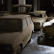 Cars from 1974 lie abandoned in an underground garage in the United Nations Buffer Zone in central Nicosia March 12, 2014. The cars were imported from Japan and intended to be sold at a Toyota dealership. They were stored here for safety during the 1974 conflict but have never been moved since. Some cars have only 32 miles on the clock. This year marks 40 years since the Cyprus National Guard staged a coup in Cyprus and the subsequent Turkish military intervention, which escalated a civil war between the Greek and Turkish Cypriot communities on the island. After the ceasefire a heavily restricted UN controlled Buffer Zone between the north and south of the island was put into operation. It stretches 180 Km across the whole island measuring 7.4 km at its widest and 3.3 meters at its narrowest point. It is restricted to the general public and no Greek or Turkish Cypriots are allowed inside. REUTERS/Neil Hall (BRITAIN)