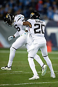 Jacksonville Jaguars cornerback Jalen Ramsey (20) shoves Jacksonville Jaguars rookie defensive back Ronnie Harrison (36) in celebration after Harrison intercepts a first quarter pass and returns it 14 yards to the Jaguars 40 yard line during the week 14 regular season NFL football game against the Tennessee Titans on Thursday, Dec. 6, 2018 in Nashville, Tenn. The Titans won the game 30-9. (©Paul Anthony Spinelli)